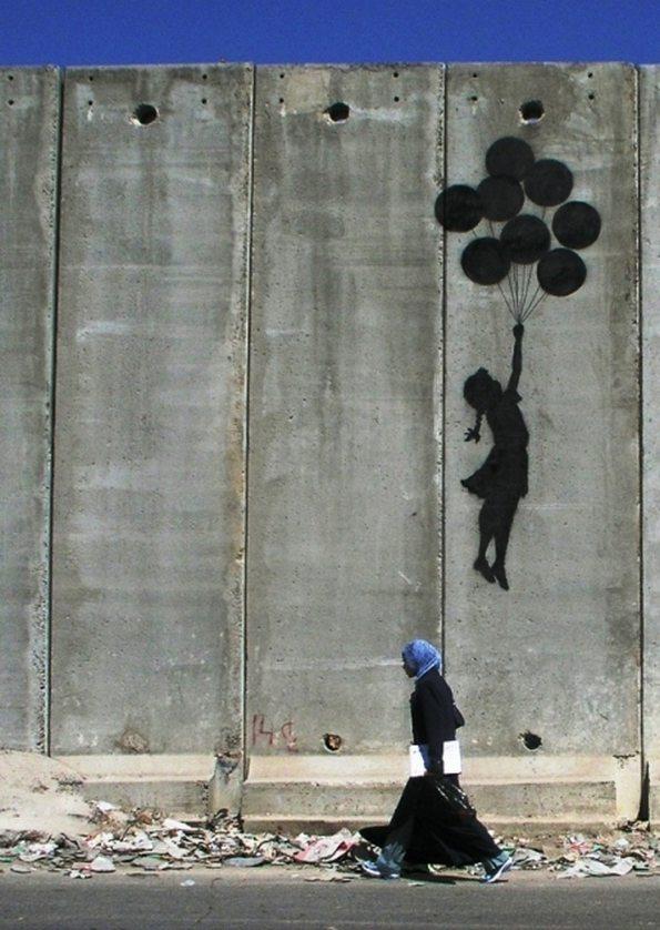 Muren på Vestbredden med Banksys grafitti. Bildet: Wall in Palestine